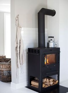 """What You Should Do About Fireplace with Wood Storage Beginning in the Next 9 Minutes The fireplace looks fantastic!"""" Especially in the event the fireplace is in your room or you're the sole guests that day. A lovely fireplace in… Continue Reading → Style At Home, Wood Stove Decor, Wood Stove Wall, Wood Stove Surround, Norwegian House, Norwegian Wood, Wood Burner, Foyers, Home Fashion"""