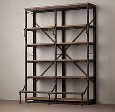 RH's French Library Double Shelving:A reproduction of a mid-1940s eastern European library bookcase, ours is heir apparent to the imperfect beauty of an antique. Crafted from iron and hardwood, it displays books and other collectibles from four open sides. Distressed to replicate its forebear with the patina of age, our shelving's front handles and lower bar step are functional vestiges of its earlier employment, equipping it for moves and reaching the upper tiers as necessary.