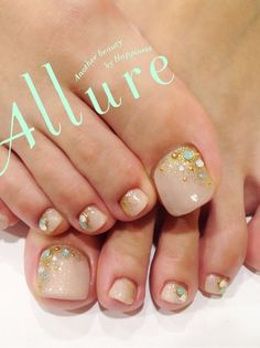 nude toe nails with turquoise and gold accents...