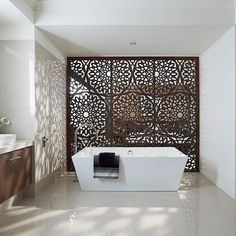 Great cutout screen that separates this bathroom from the bedroom. #decor