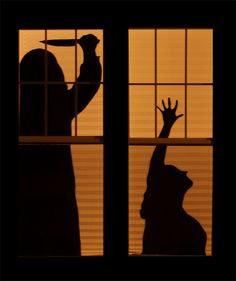 Window silhouettes DIY: front dining room and garage windows!!! Goes well with the Dead and Breakfast theme....