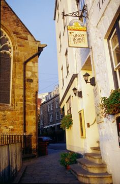 St. Peter Port -- The closest pub to a church in the British Isles is found in St. Peter Port, Guernsey, with the Town Church and Albion pub separated only by a very narrow way!