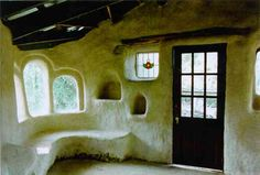 Cob house interior. Anyone can build with cob. It is fire resistant, bug resistant, earthquake resistant, cool in the summer and warm in the winter, labor intensive but inexpensive to construct, easy to renovate and repair, environmentally friendly.