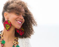 The earrings are made with hard paper and covered with colorful African fabric. The paper makes it very light to wear and it doesn't put any heavy weight to your ears.