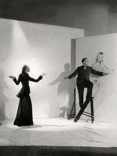 Photograph of artist, Christian Berard who is drawing a mode by Cecil Beaton