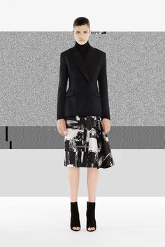 The latest work of Australian fashion designer Josh Gootis an intriguing lesson in what happens when someone who usually experiments with rich floral prints and bright color blocking, breaks his design down to a reduced palette of mainly black and white. It results in a timeless, calm collection with an interesting androgynous appeal. And as we are talking about a skilled designer with a strong handwriting, it is still very recognizably a Josh Goot collection: