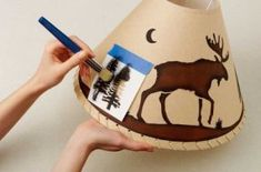 Use this easy, beautiful stencil design to add rustic charm your home. Learn to use this stencil design to decorate a Rustic Moose Lampshade.