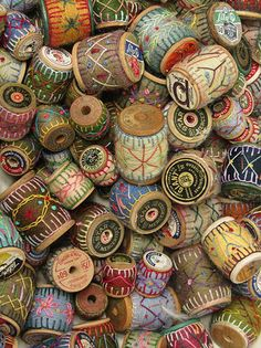 Putzy, but what a beautiful display this would make with the old wooden spools, felt and some yarn stitching for accent.