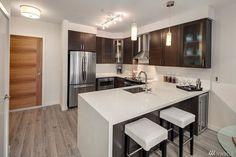 Contemporary Kitchen with Flush, Wine refrigerator, Bellmont Cabinets Nova, Breakfast bar, L-shaped, Hardwood floors