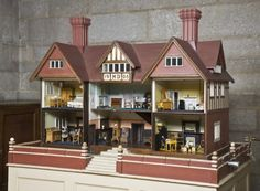 The doll's house in the Service Corridor at Castle Drogo, Devon, made for the Drewe's elder daughter Mary in 1906 by a carpenter at Wadhurst Hall.