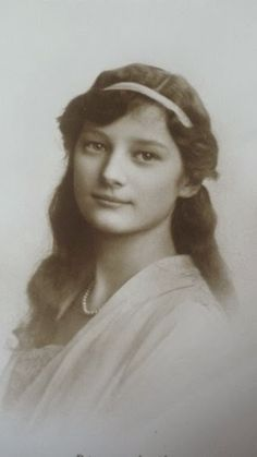 Princess Astrid of Sweden, later Queen of Belgium. It is me or she looks like Tatiana Nikolevna ?