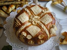 "Slavski kolac| ""Slava bread or slavski kolac is an important part of the religious aspects of Krsna Slava, or the celebration of a Serbian family's patron saint day. In many homes, the parish priest comes to the home to bless the bread before any festivities can begin"" 