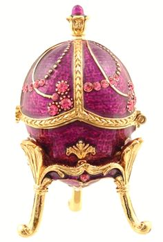 This beautifully designed purple faberge  egg replica will bring beauty to any  collectible collection. It stands on golden  legs and opens to reveal a compartment  for your small jewelry.