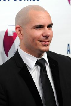Pitbull- Not a song he has created that I don't LOVE! And how handsome is a rapper in a tie? Pitbull The Singer, Pitbull Rapper, Pitbull Photos, The Power Of Music, Bald Men, Shaved Head, Music Artists, Bald Heads, Pitbulls