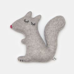 Meet Doris  Doris is knitted using a lovely grey lambswool and is stuffed with polyester stuffing. Her face and tail are hand embroidered.  Height: 25cm