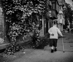 old age - old woman walking in the street Photo by Andriy Solovyov on www.solovyov.biz