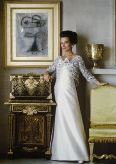 Photograph of socialite Lee Razdiwill taken by Mark Shaw in 1964. Lee was the younger sister of Jacqueline Kennedy and was married to Polish royalty. Her homes in England as well as the United states are well documented. Lee Radziwill is considered a great style icon of this period. Her palatial homes in England were decorated by the late Renzo Mongiardino. She is captured in a white satin gown by Lanvin.
