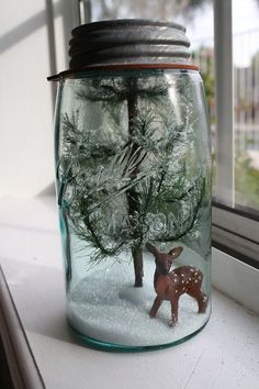 """It's so easy to create your own Christmas terrarium. Just take a Mason jar, fill it with """"snow"""" and add a Christmas tree and a reindeer for a DIY Christmas scene that will last forever. Change up the reindeer to a Santa for a different look."""