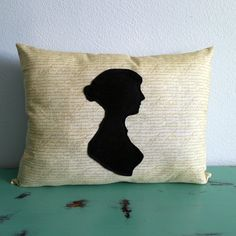 Jane Austen Silhouette Pillow on black and cream script fabric. $20.00, via Etsy.
