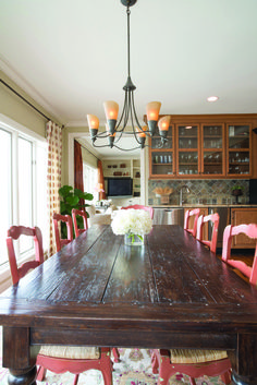 photo by Med Dement  #diningroom #diningtable #redchairs #rustic #rusticchic #chandelier #chattanooga #cha