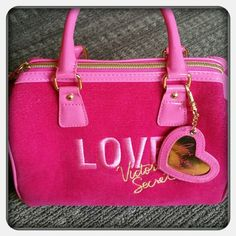 REDUCED*VS LOVE SPRING PINK VELVET PURSE/BAG Super stunning!  This is a Victoria Secret pink velvet purse/bag with pink patent trim.   A removable heart key chain, LOVE embroidered in the front in pink.  The inside is lined with pink satin and the Victoria Secret name printed throughout.   This was only used once, in excellent condition. Victoria's Secret Bags