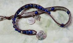 "Beautiful Lapis and silver plated cube beads stitched onto distressed brown leather. Silver tone button closure and features a silver filigree heart and ""inspire/believe"" charms."