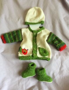 I was inspired by the story, which I was sharing with my grandson Harry. You know when there's a little egg of an idea  in your head and it just has to be let out? This is the result of that egg ..   It  became a caterpillar cardigan. Then I felt it needed a pair of booties and finally a hat.