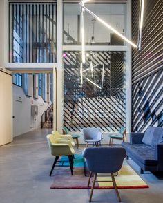 Google Madid Campus tak their latest co-working offices in a former electrical battery factory to accommodate 7,000 members in the río area of the spanish capital. to design the shared workspace, london-based architecture and interiors practice Jump Studios