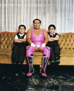 Villano III with his twin sons in Mexico City, 2003 Mexican wrestlers often come from long family lines of luchadores  Photographer Katinka Herbert