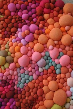 Honestly, this excites me so much, I can hardly stand it. Chilean artist Serena Garcia Dalla Venezia creates small and large scale installations made of colorful, hand sewn fabric. They are out of this world! I can imagine how the incredible tactile quality of her work makes it impossible to