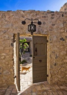 Garden doors in a rustic stone wall.  Southwestern or Tuscan