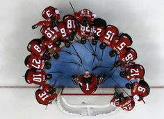Canada's women's ice hockey team surrounds goalie Shannon Szabados before their women's ice hockey game against Finland at the 2014 Sochi Wi...