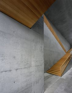 mixed use of wood and concrete: Museum Georg Schäfer | What an amazing and modern staircase design.