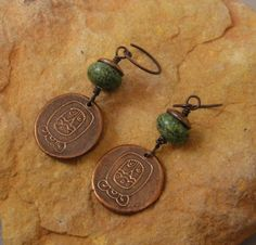 Handcrafted Artisan Jewelry, Handmade Copper Mayan Symbol Dangle Earrings, Sundance Style. $22.00, via Etsy.