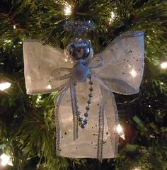 Christmas angel craft to make a napkin ring that turns into a Christmas ornament. Frugal Christmas, Christmas Angel Ornaments, Christmas Tea, Christmas Ribbon, Holiday Crafts, Christmas Decorations, Memorial Ornaments, Diy Angels, Christmas Thoughts