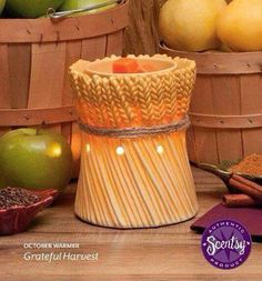 "Scentsy October 2014 Warmer of the Month- ""Grateful Harvest"". Celebrate the abundance of fall with Grateful Harvest, an enduring symbol of a rich and plentiful season. Hand-painted in earthly tan and gold with a jute ""tie"", this porcelain warmer glows when lit. It is the perfect fall accent for any room! 10% off the month of Oct 2014."