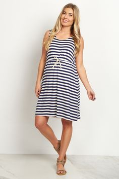 Perfect for summer weather, this striped maternity dress is sure to show off your bump in style. A cinched waistband and striped print give you a nautical look that can keep you cool. Style this dress with sandals or wedges for a complete look.