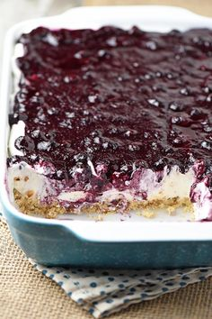 Whip up a dreamy blueberry delight. Easy recipe for a no bake blueberry dessert, made with Dream Whip, cream cheese, blueberry pie filling, and a pecan crust. recipes easy no bake videos Creamy No Bake Blueberry Delight Blueberry Yum Yum, Easy Blueberry Desserts, Blueberry Crunch, Blueberry Delight, No Bake Desserts, Easy Desserts, Delicious Desserts, Dessert Recipes, Blueberry Cheesecake