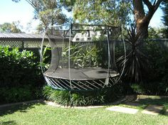 What a great idea! If the trampoline is not wanted by a future house owner, then it is easily removed and placed with a feature!