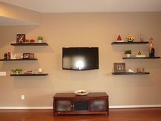 I have a large wall to fill and this is one idea of what to do with it.  In place of the TV, I could also do a mirror