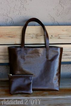 Make a sleek leather tote and change purse with this tutorial by Addicted 2 DIY.