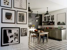 tiled floors and wall art, industrial lighting, modern kitchen
