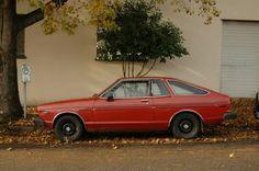 OLD PARKED CARS.: 1979 Datsun 210 Hatchback.