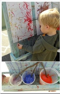 Painting with sticks at preschool
