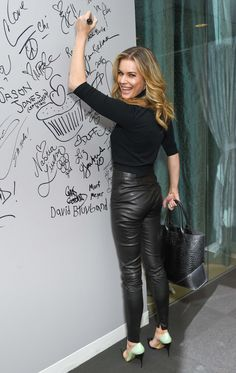 Rebecca Romijn at AOL Build in NYC black leather pants bottom