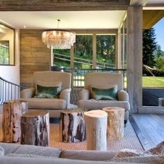 Gorgeous chalet in the Swiss Alps with a mix of modern and rustic alpine decor.