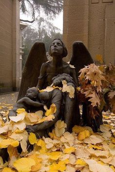 An angel watching over a mother and her child (Cimitero Monumentale (Milano) Photo by Arturo Bragaja.