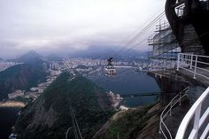 Gondola approaching the top of Sugarloaf Mountain with Rio in the background in Rio de Janeiro, Brazil #travel http://www.tourbytransit.com