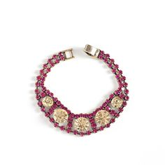 "Love this! Found it on Holly's La Bella Chic  Luella bracelet is both bold and elegant. Circular yellow crystals are the perfect complement to Luella's vibrant rows of fuchsia crystals, which taper at the ends for any more delicate effect. This unexpected piece will glam up the most neutral ensembles in a flash.   - Gold tone metal, stone, CZ's - 8"" long  - Box clasp closure $46"