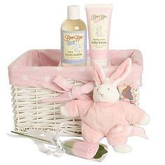 Baby Girl Bunny Gift Basket | A lovely soft and cuddly gift for a baby girl. Inside this pink and white spotty basket your lucky recipient will find a floppy bunny just waiting to be rattled, a cute pair of socks and a pair of bathtime essentials too! A perfect gift idea for a new arrival.